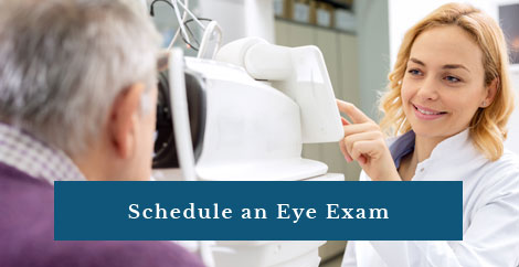 Picture of eye Dr giving an exam